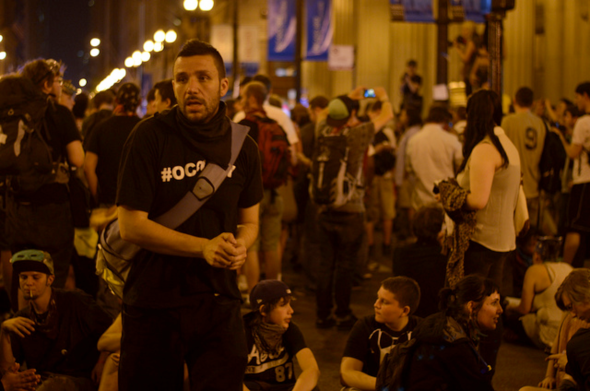 A protestor displays the Occupy movement social media hashtag (#occupy) on his t-shirt